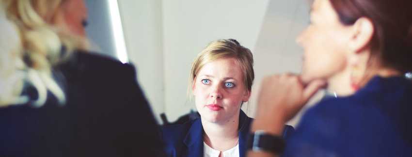 Woman sat in Interview room